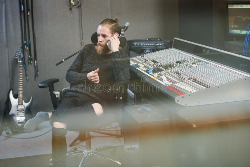 Sound producer speaking on phone stock image