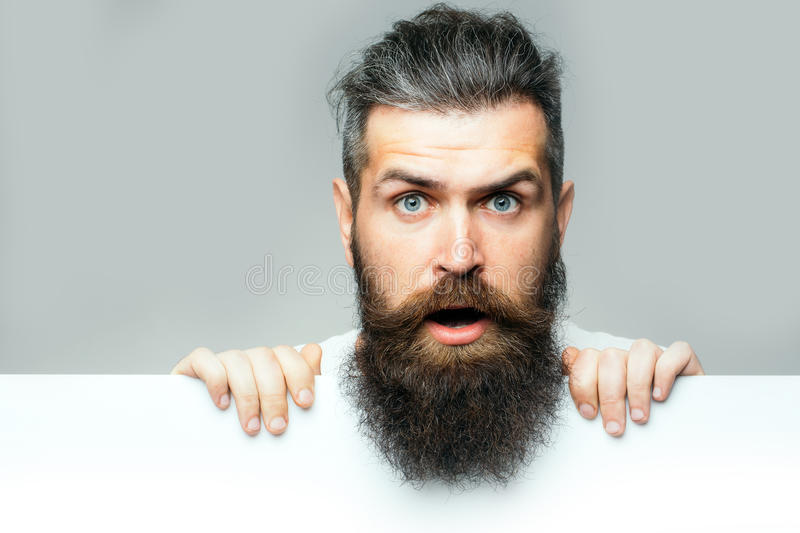 Bearded surprised man with paper stock photo