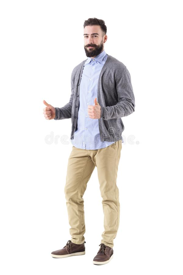 Bearded teacher or businessman smiling and showing thumbs up in formal clothes stock photo