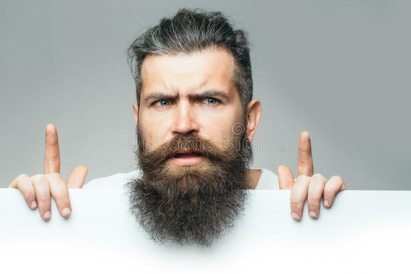 Bearded thougtful man with paper royalty free stock photos
