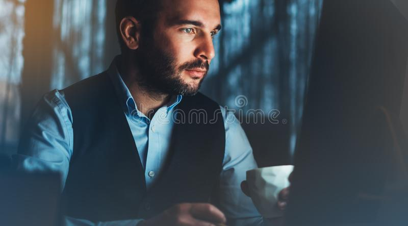 Bearded young businessman working on modern office. Consultant man thinking looking in monitor computer. Manager typing on keyboar. D in coworking workplace stock photos