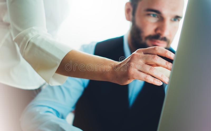Bearded young businessman working on office. Director man thinking looking in monitor computer. Managers meeting. Idea, alalyze ma. Rketing plans. Workplace royalty free stock photos