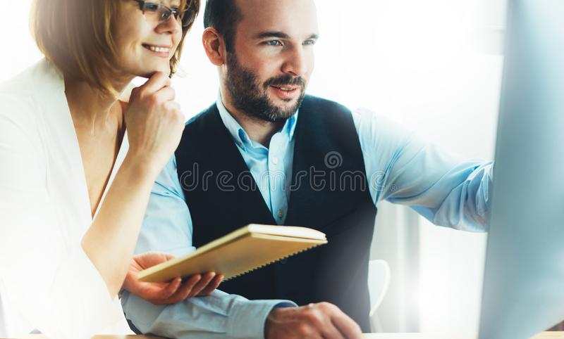 Bearded young businessman working on office. Director man thinking looking in monitor computer. Managers meeting. Idea, alalyze ma stock photo