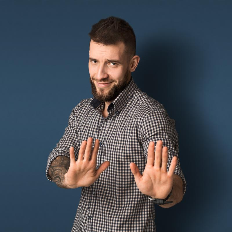 Bearded young man expressing refuse stock images