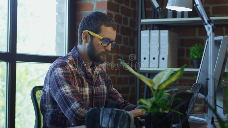 Focused bearded man using computer royalty free stock images