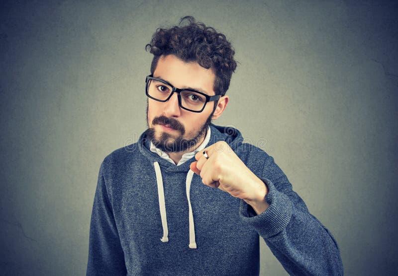 Aggressive man threatening with fist stock photo