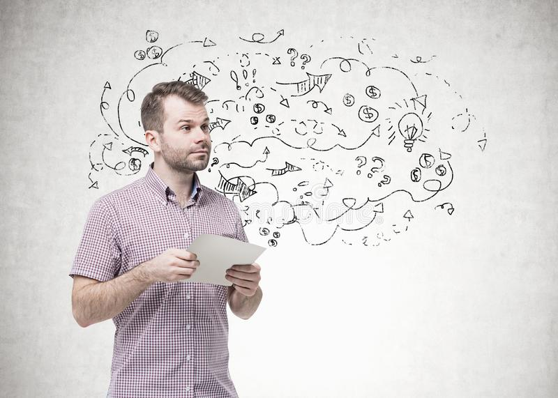 Bearded young man holding paper, arrows stock photo