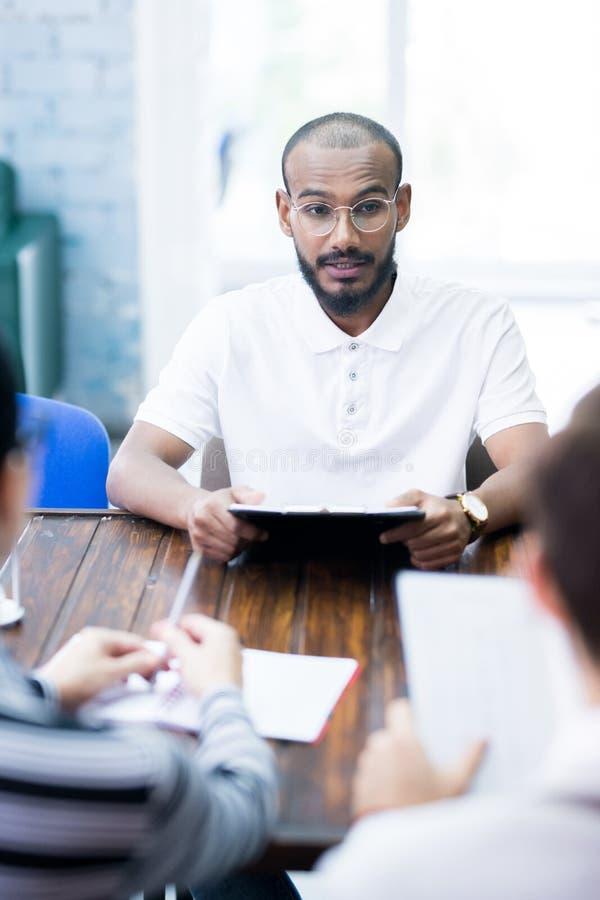 Young man at job interview stock photos