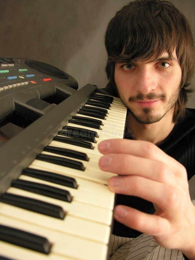 Beardman avec le piano photos libres de droits
