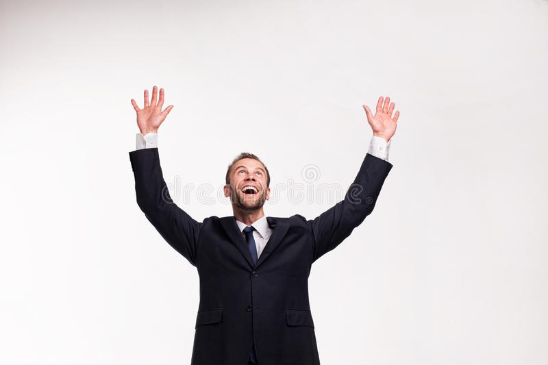 Beardy businessman raising his hands up royalty free stock images