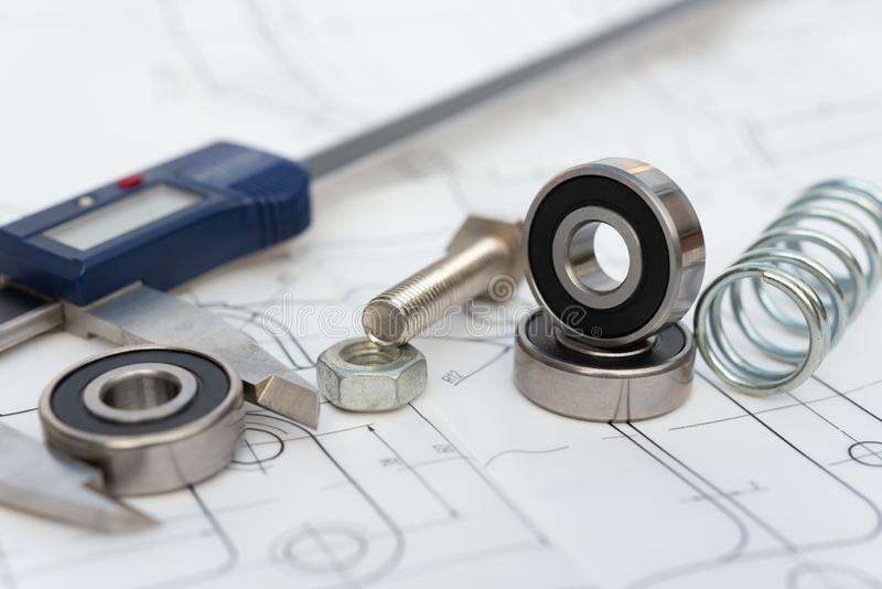 Bearing and caliper and spring and bolt with nut on mechanical engineering drawing royalty free stock image