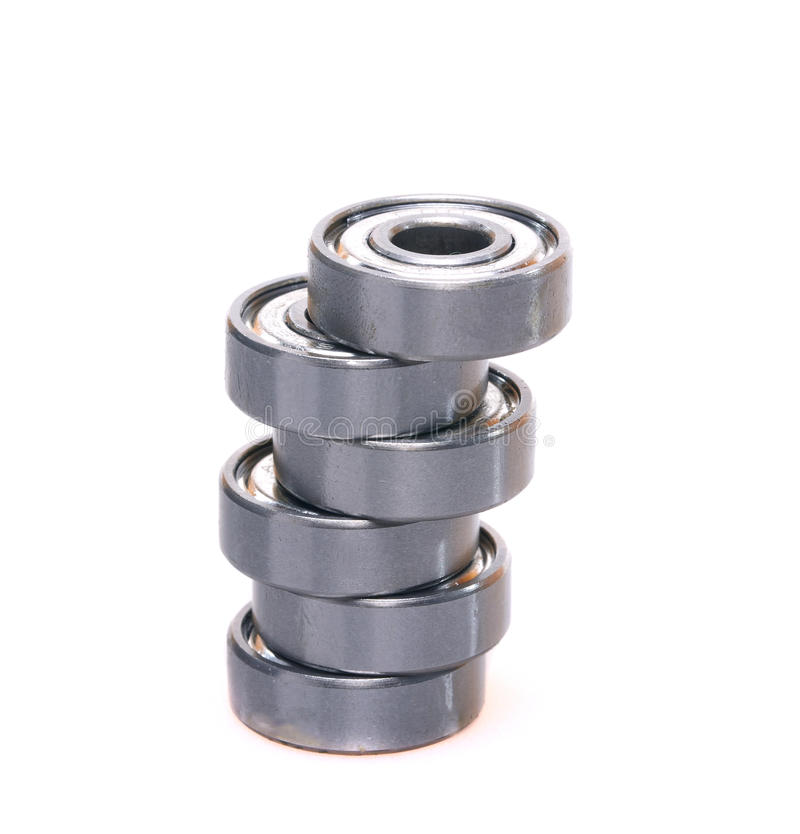 Bearing pile. Metal bearing pile over white background, spares part royalty free stock photo
