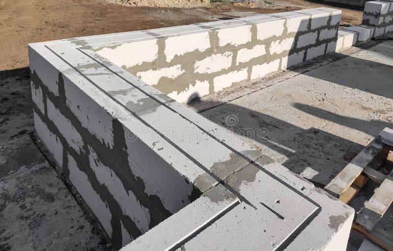 Bearing walls reinforcement laying aerated concrete blocks. Building a house. In Ukraine stock photo