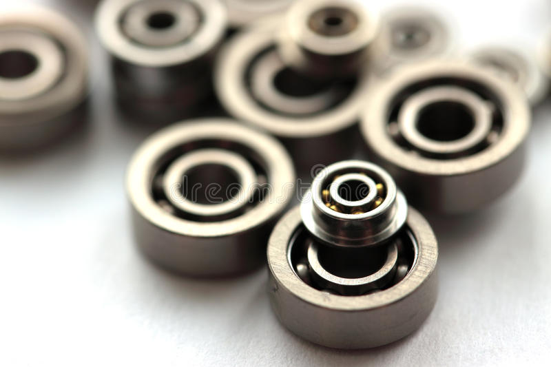 Bearings. Group of bearings of different diameter on white background stock photography