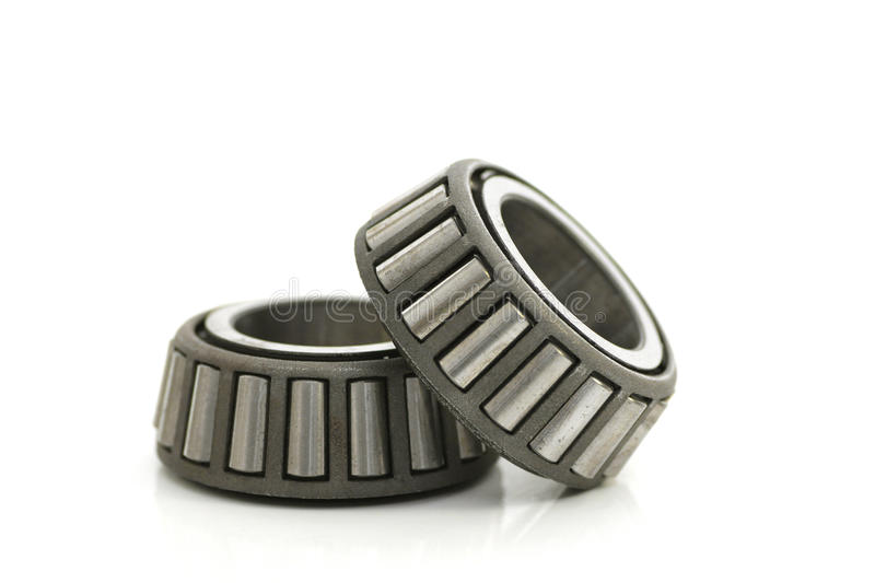 Bearings. Two precision metal bearings on a white background royalty free stock images