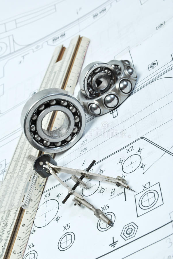 Bearings. And various tools on drawing royalty free stock photos
