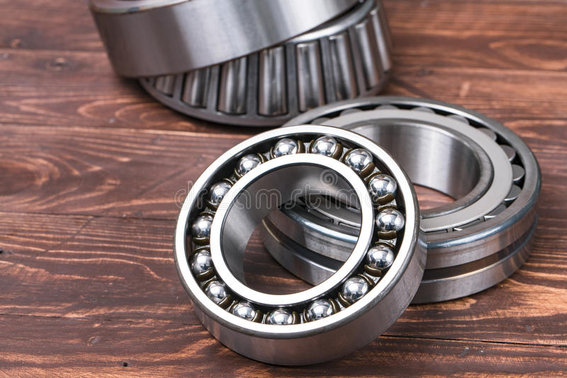 Bearings isolated on background old wood. royalty free stock images