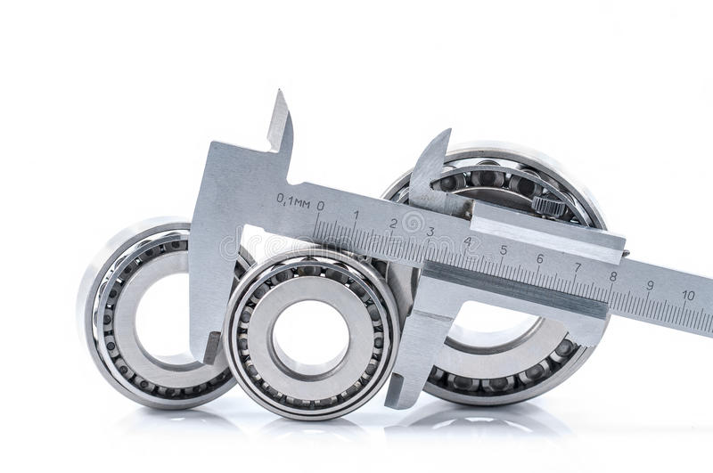 Bearings measuring device. Photo bearings the measuring device of diameters on a white background stock photography