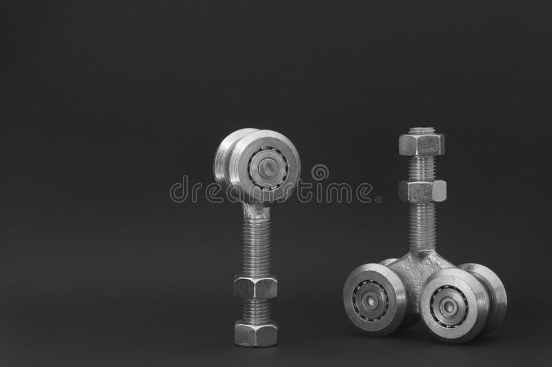 Bearings for sliding gates isolated on a black background. Closeup of sliding bearings for industrial gates royalty free stock image
