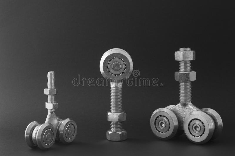 Bearings for sliding gates isolated on a black background. Closeup of sliding bearings for industrial gates royalty free stock photography