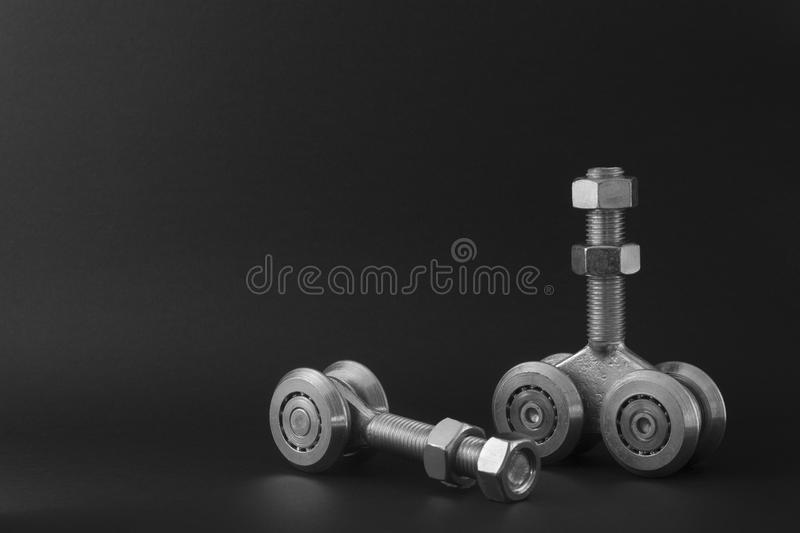 Bearings for sliding gates isolated on a black background. Closeup of sliding bearings for industrial gates stock photography