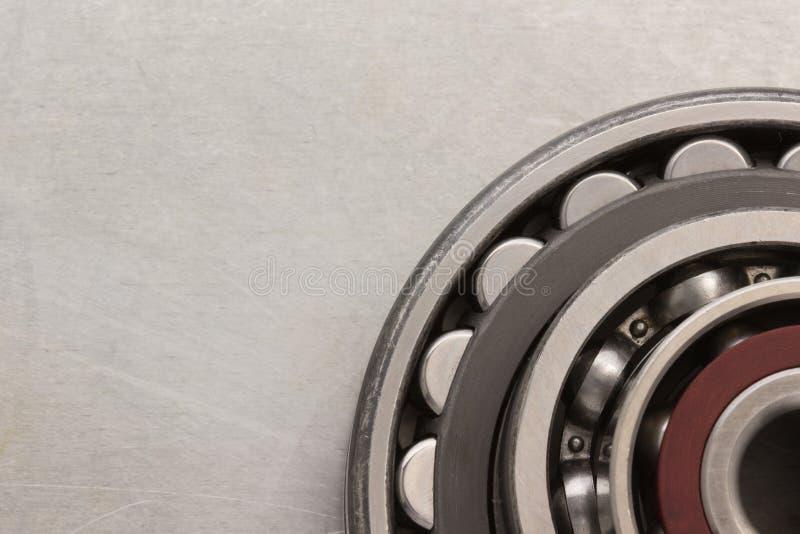 Bearings tool. Bearings at metal background texture stock images