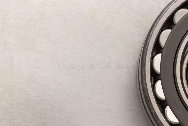 Bearings tool. Bearings at metal background texture royalty free stock image