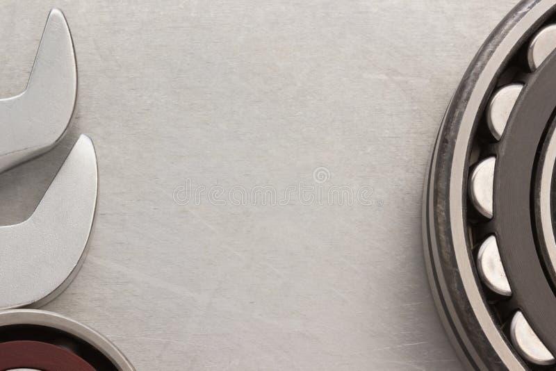 Bearings tool. Bearings at metal texture background royalty free stock photography