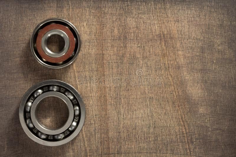 Bearings tool at wooden background. Surface royalty free stock images