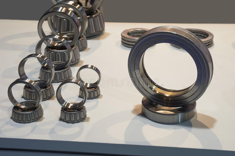 Bearings on the table. Bearings of various sizes and types on the table stock photography