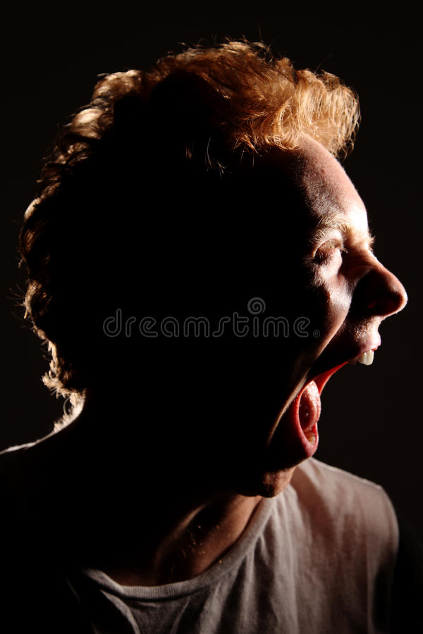 Download Beastly Man Tearing Mouth Open Stock Image - Image: 10591787