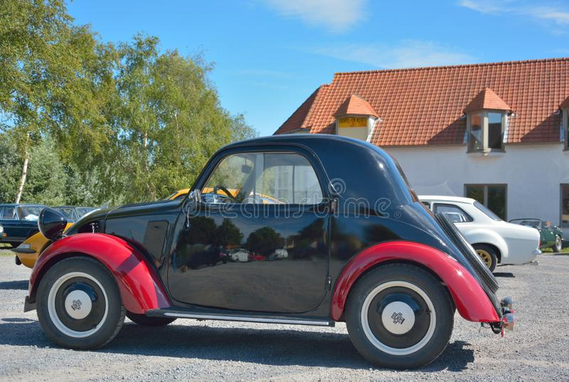 Beatiful black and red old timer at a car show in oudenburg, Belgium. Belgium, Oudenburg, August 2018: beautiful black and red old timer at a car show in stock images