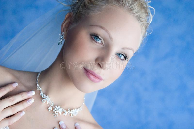 Beatiful bride with a necklace stock photos