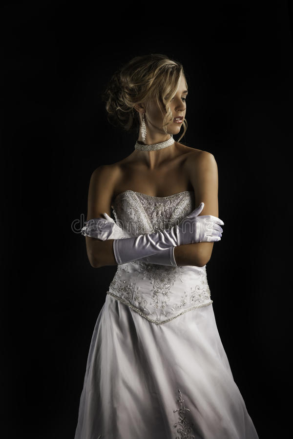 Beatiful bride in wedding dress with gloves stock photography