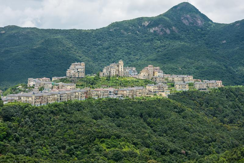 A beatiful castle in the valley and mountains background at Shenzhen Overseas Chinese Town East OCT East in Guangdong, China. A. Resort with three themed parks stock photos