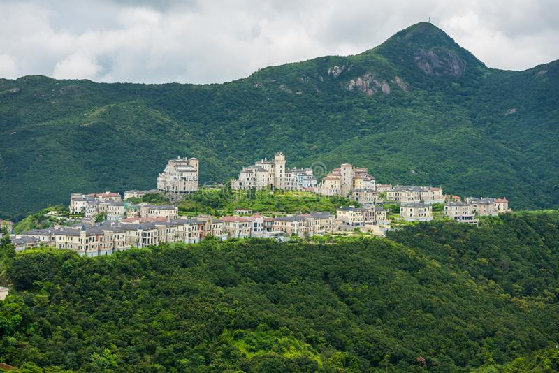 A beatiful castle in the valley and mountains background at Shenzhen Overseas Chinese Town East OCT East in Guangdong, China. A. Resort with three themed parks royalty free stock photos