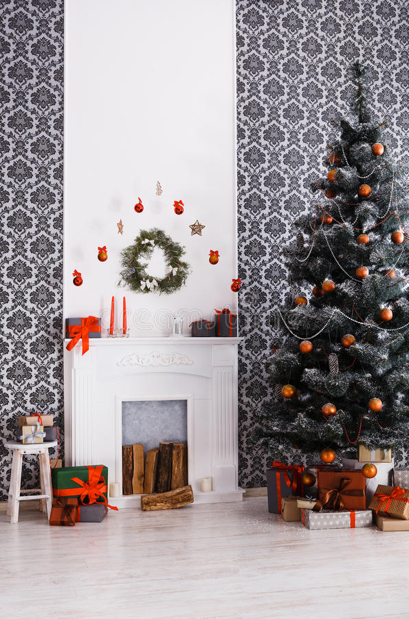 Beatiful christmas decorated tree in modern interior, holiday concept royalty free stock images