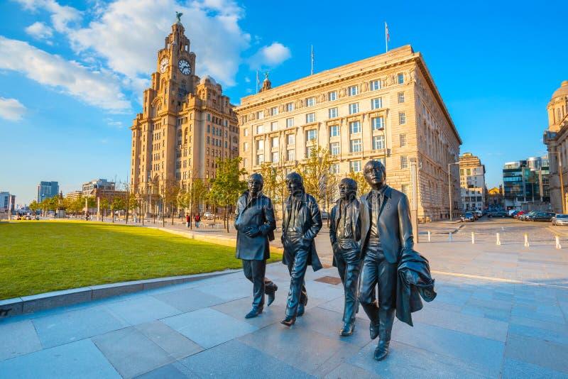 Beatles的古铜色雕象在默西赛德郡的在利物浦,英国 免版税库存照片