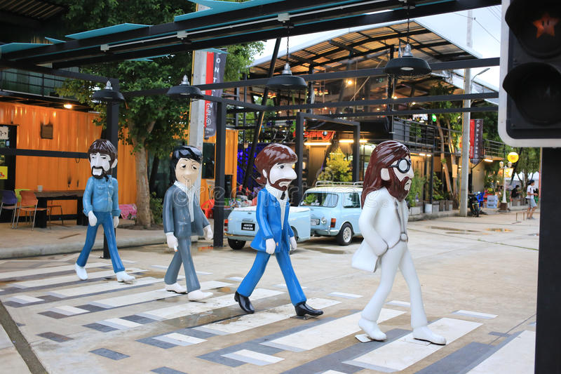 He Beatles Abbey Road zebra crossing fiberglass statue. Trang, Thailand - September 5, 2016: The Beatles Abbey Road zebra crossing fiberglass statue at Cinta stock photography