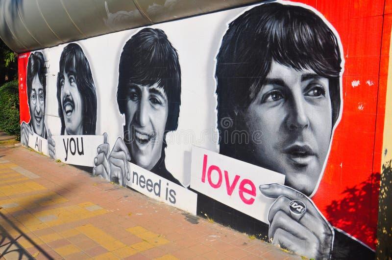 Beatles målning på en vägg royaltyfri bild