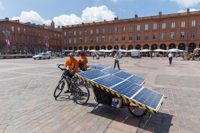 Beatrice and Yannick on their solar bikes. TOULOUSE, FRANCE - JULY 22, 2014: A year before Sun Trip 2015 from Milan to Astana, Beatrice and Yannick do a mini stock photo