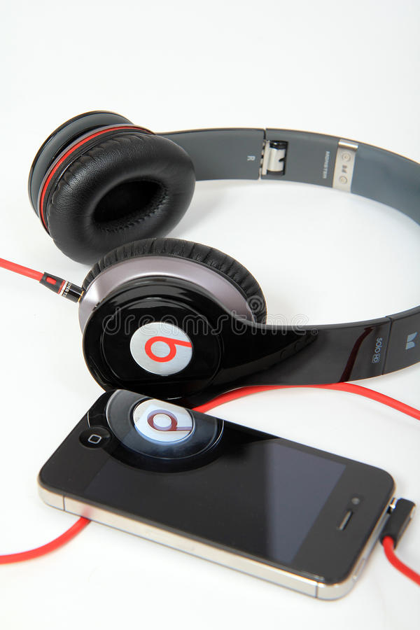 Beats by Dr. Dre Solo HD. With Apple iPhone on white background royalty free stock images