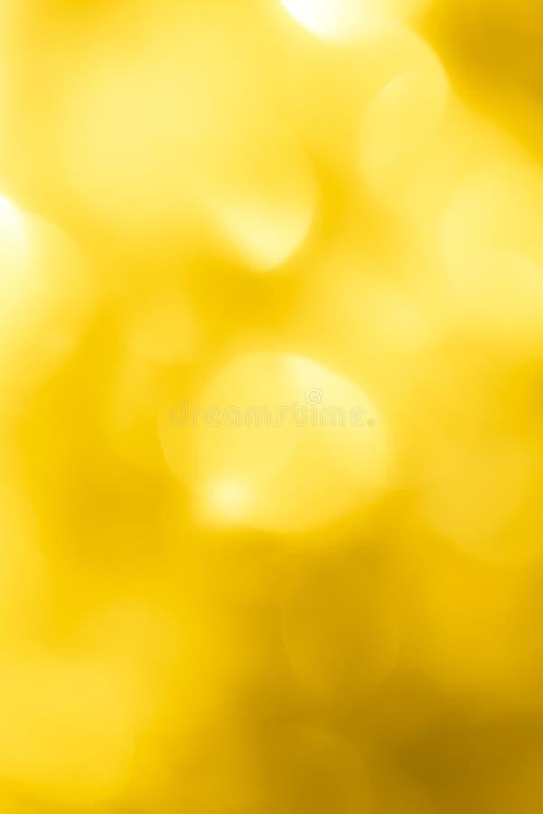 Beau bokeh jaune de fête Fond image libre de droits