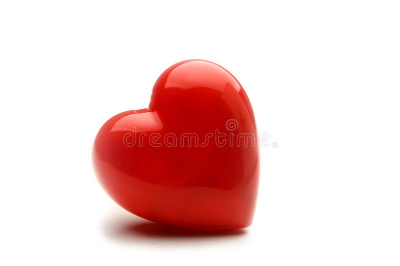 Beau coeur rouge d'isolement sur le fond blanc photos stock