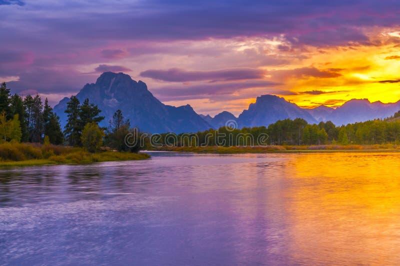 Beau coucher du soleil chez Grant Tetons image stock