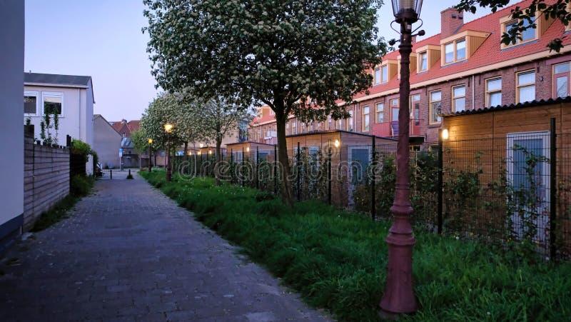 Beau coucher du soleil d'Amsterdam Vieilles maisons n?erlandaises typiques sur le pont et les canaux au printemps photo libre de droits