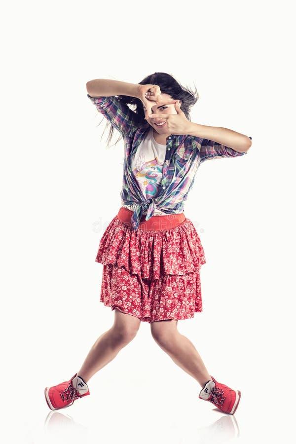 Beau danseur de fille de style moderne posant sur le fond blanc d'isolement photographie stock