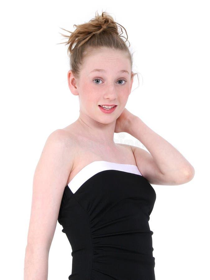 Beau de l'adolescence dans la robe formelle noire photos stock