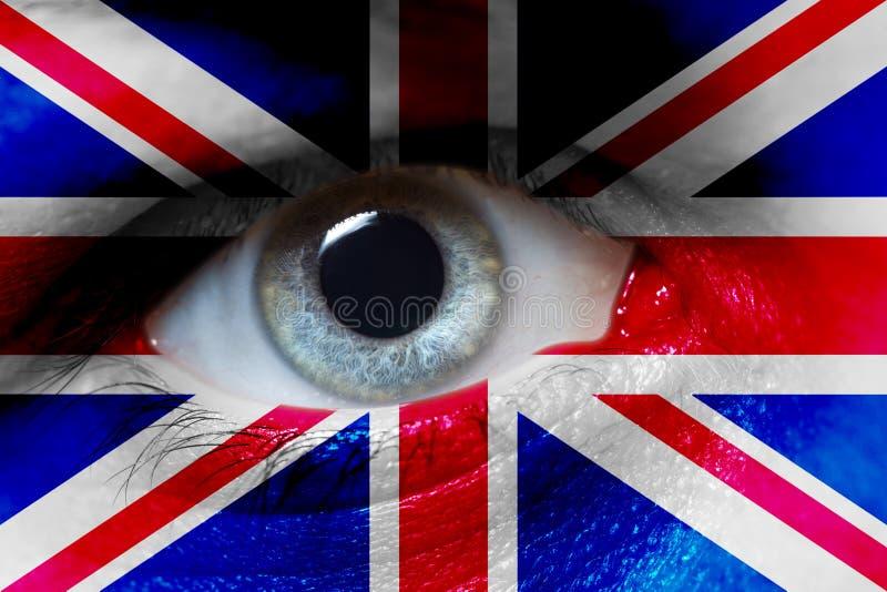 Beau drapeau de l'Angleterre sur le visage de l'oeil humain photographie stock libre de droits