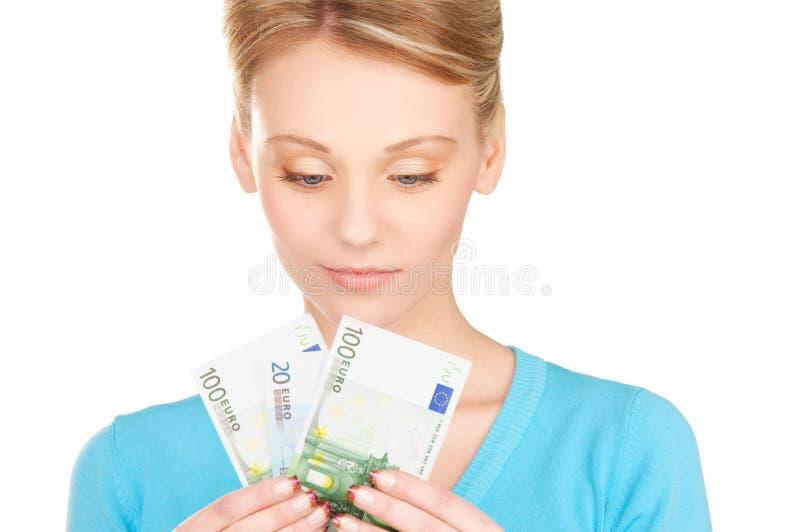 Beau femme avec de l'argent photo stock